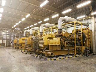 large yellow generators in a warehouse setting